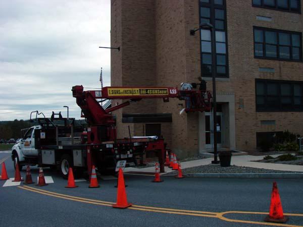 Crews install lower bracket arm