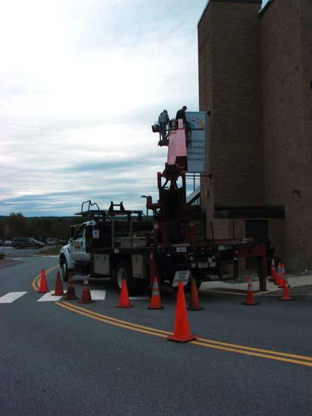 Crews install banner on bracket