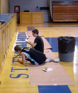 Jason & Ross Suleski painting gym floor